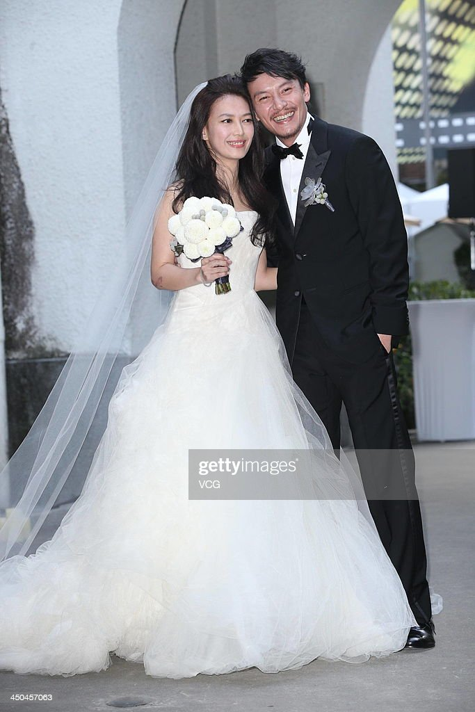 Actor Chang Chen and his wife Ann pose for photos at their wedding ceremony on November 18, 2013 in Taipei, Taiwan.