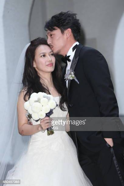 Actor Chang Chen and his wife Ann pose for photos at their wedding ceremony on November 18 2013 in Taipei Taiwan