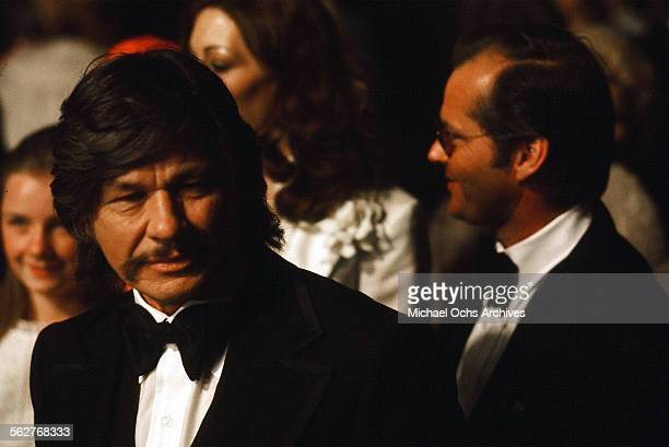 Actor Charles Bronson arrives along with Jack Nicholson and actress Anjelica Huston to the 48th Academy Awards at Dorothy Chandler Pavilion in Los...