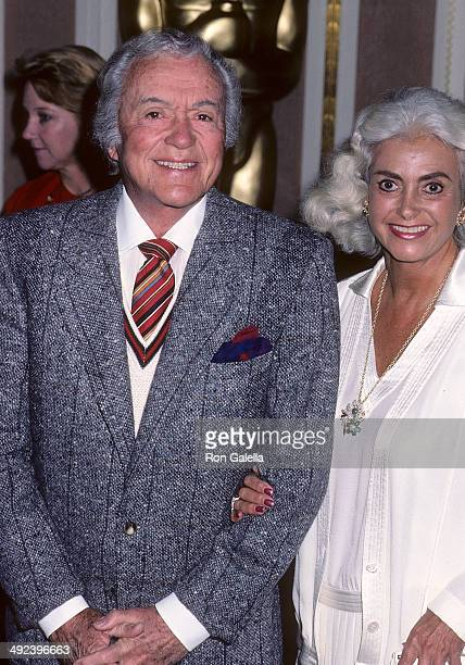 Actor Charles Buddy Rogers and wife Beverly Ricondo attend the 58th Annual Academy Awards Nominees Luncheon on March 13 1986 at the Beverly Hilton...