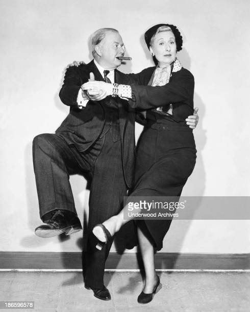 Actor Charles Coburn tries dancing the Charleston with his partner Hollywood California late 1930s