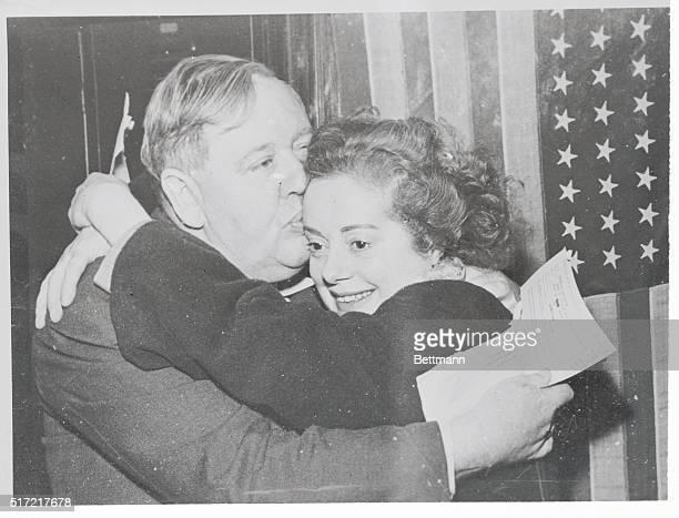 Actor Charles Laughton and his actress wife Elsa Lanchester embrace after receiving their US citizenship papers in Los Angeles They were among a...