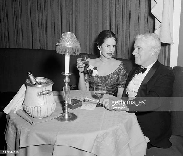 Actor Charlie Chaplin is shown with his wife, actress Oona O'Neill, at the El Morocco nightclub in New York City.