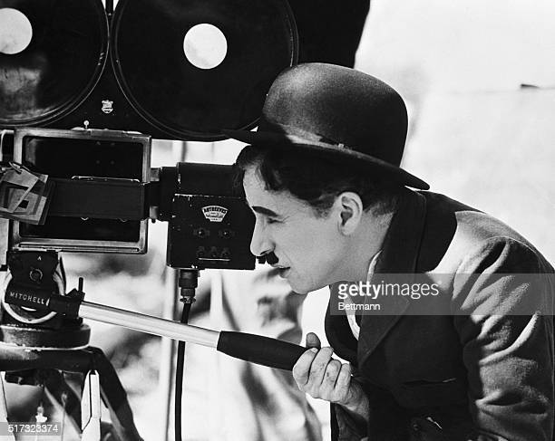 Actor Charlie Chaplin looks though a movie camera on April 22 1935 He is directing as well as acting in a comedy tentatively titled Production No 5