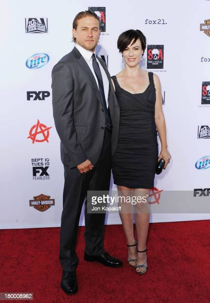 Actor Charlie Hunnam and actress Maggie Siff arrive at FX's 'Sons Of Anarchy' Season 6 Premiere Screening at Dolby Theatre on September 7 2013 in...