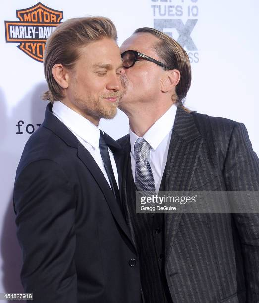 Actor Charlie Hunnam and executive producer Kurt Sutter arrive at FX's Sons Of Anarchy premiere at TCL Chinese Theatre on September 6 2014 in...