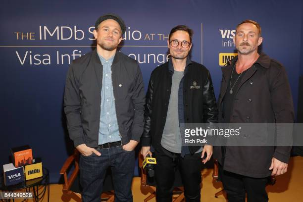 Actor Charlie Hunnam director Michael Noer and actor Roland Moller of 'Papillon' attend The IMDb Studio Hosted By The Visa Infinite Lounge at The...