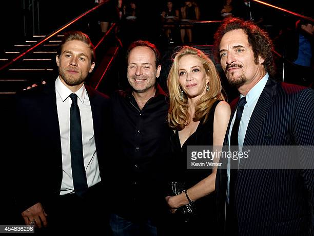 Actor Charlie Hunnam John Landgraf CEO FX Network his wife actress Ally Walker and actor Kim Coates pose at the after party for the season 7 premiere...