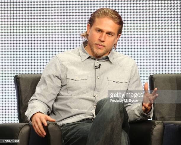 "Actor Charlie Hunnam speaks onstage during the ""Sons of Anarchy"" panel discussion at the FX portion of the 2013 Summer Television Critics Association..."