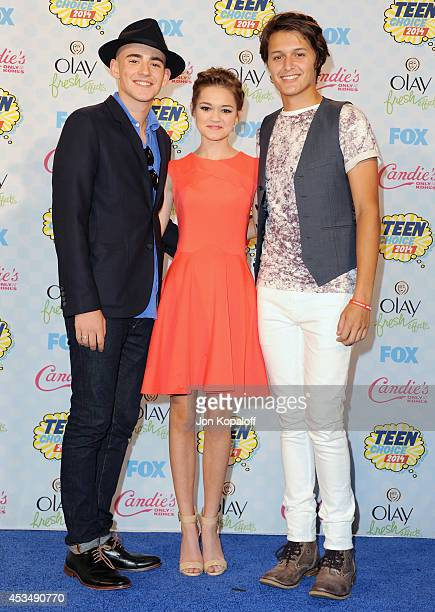 Actor Charlie Rowe actress Ciara Bravo and actor Nolan A Sotillo pose in the press room at the 2014 Teen Choice Awards at The Shrine Auditorium on...