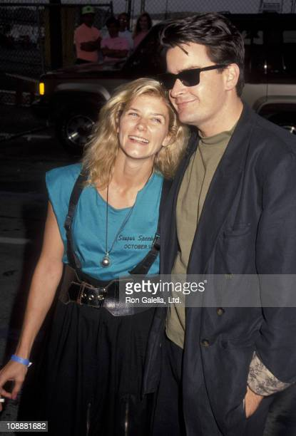 Actor Charlie Sheen and adult film actress Ginger Lynn attend Second Annual Reid Rondell Stunt Foundation Enduro 150 on October 6, 1990 at Saugus...