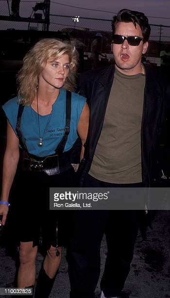 Actor Charlie Sheen and adult film actress Ginger Lynn attend Second Annual Reid Rondell Stunt Foundation Enduro 150 on October 6 1990 at Saugus...