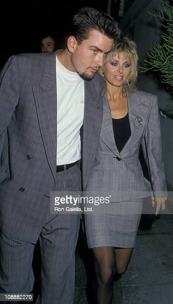 Actor Charlie Sheen and Cathy St George sighted on May 6 1988 at Spago Restaurant in West Hollywood California