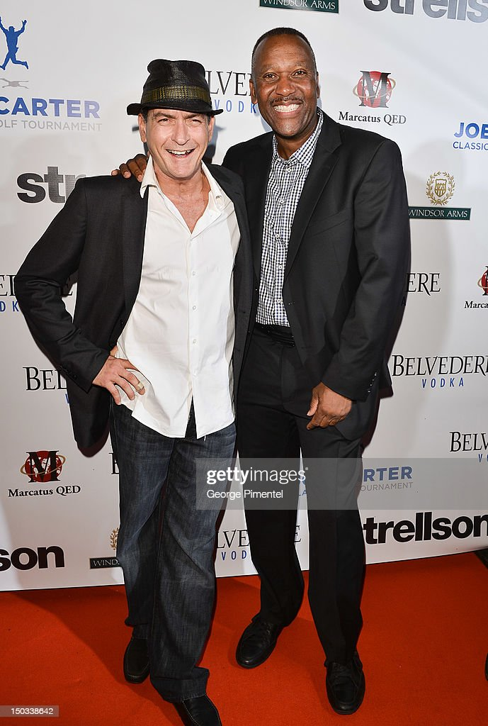 Actor Charlie Sheen and Ex Toronto Blue Jay player Joe Carter attend the Joe Carter Classic After Party to support the Children's Aid Foundation at Windsor Arms Hotel on August 15, 2012 in Toronto, Canada.