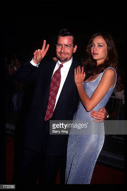 Actor Charlie Sheen and his wife Donna Peele attend the opening of Planet Hollywood September 17 1995 in Los Angeles CA The Beverly Hills branch had...