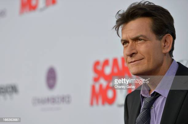 Actor Charlie Sheen arrives at the premiere of 'Scary Movie V' presented by Dimension Films in partnership with Lexus and Chambord at the Cinerama...