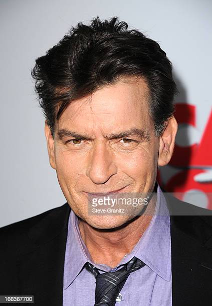 Actor Charlie Sheen arrives at the 'Scary Movie V' Los Angeles premiere at ArcLight Cinemas Cinerama Dome on April 11 2013 in Hollywood California