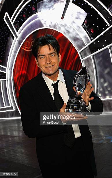 Actor Charlie Sheen poses with his award for Favorite TV Comedy in the audience during the 33rd Annual People's Choice Awards held at the Shrine...