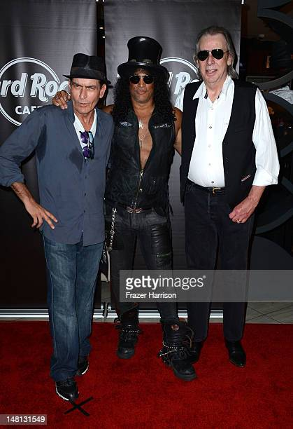 Actor Charlie Sheen Slash and DJ Jim Ladd at the Hard Rock Cafe after Slash was honored with the 2473rd Star on the Hollywood Walk of Fame on July 10...