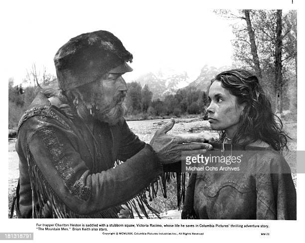 Actor Charlton Heston and actress Victoria Racimo on the set of Columbia Pictures movie The Mountain Men in 1980