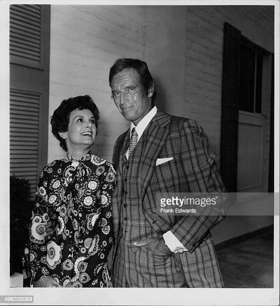 Actor Charlton Heston and his wife Lydia attending the 75th birthday party of director Alfred Hitchcock Chasen's Hollywood August 12th 1974