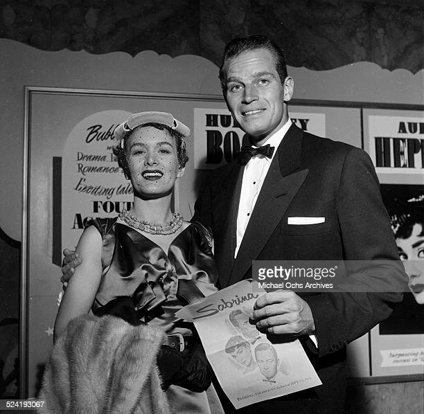 Actor Charlton Heston and his wife Lydia Clarke attend the movie premiere of Sabrina in Los AngelesCA