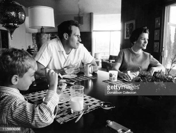 Actor Charlton Heston at the breakfast table with his wife Lydia Clarke and their son Fraser Clarke Heston in 1959