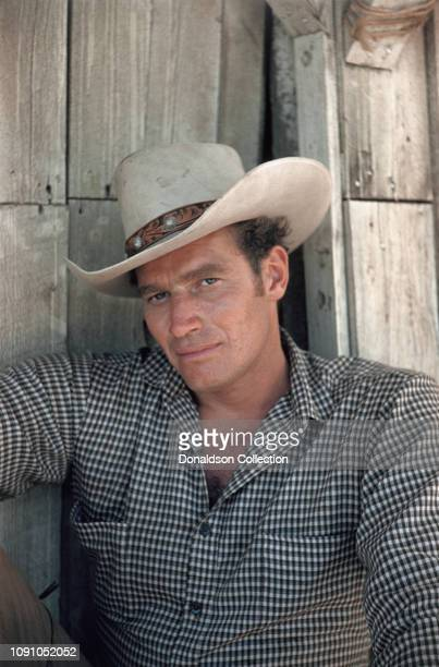 "Actor Charlton Heston on the set of the 1958 Western ""The Big Country""."