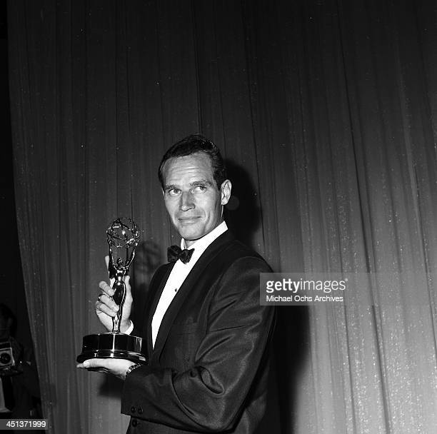 Actor Charlton Heston poses with a Emmy Award in Los Angeles California