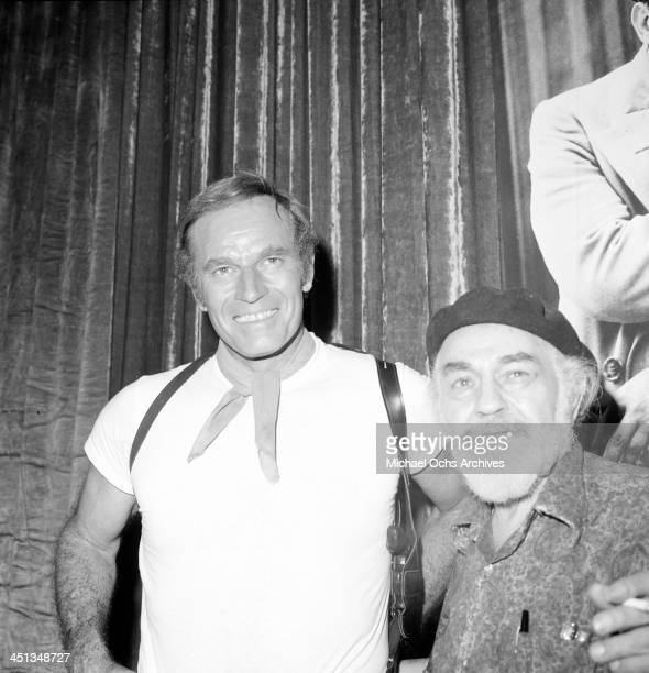 Actor Charlton Heston poses with Edward G Robinson in Los Angeles California