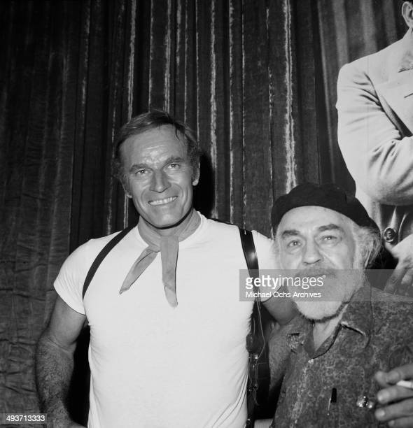 Actor Charlton Heston poses with Edward G. Robinson in Los Angeles, California.