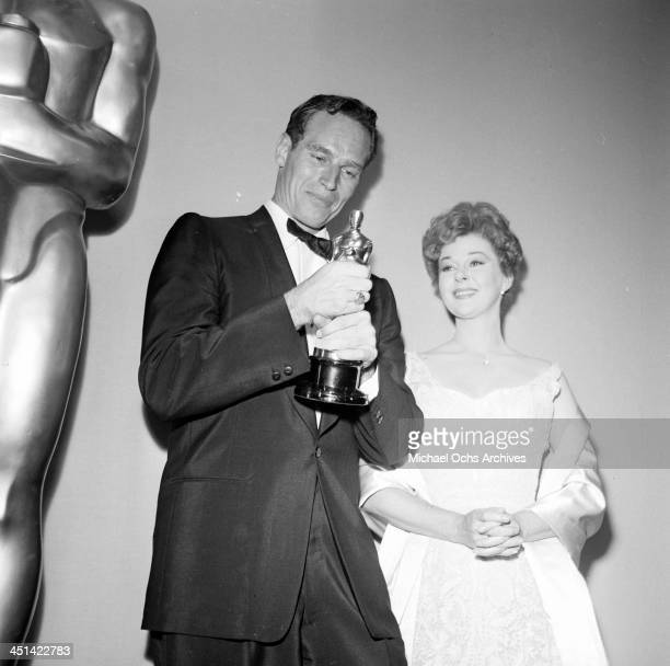 Actor Charlton Heston poses with Susan Hayward after winning the Academy Award for Ben Hur in Los Angeles California
