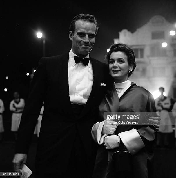 Actor Charlton Heston with wife Lydia at the premier of The Man Who Knew Too Much in Los Angeles California