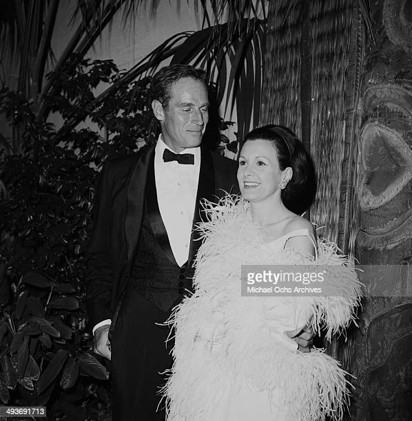 Actor Charlton Heston with wife Lydia attends a party in Los Angeles California