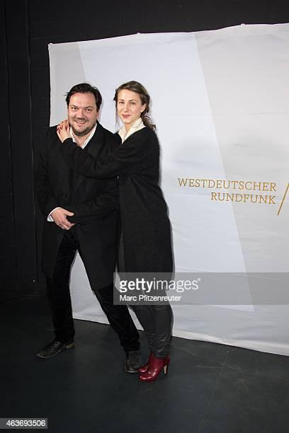 Actor Charly Huebner and actress Natalia Belitski attend the premiere of 'Vorsicht vor Leuten' at the Cinenova on February 17 2015 in Cologne Germany