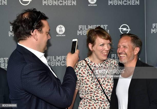 Actor Charly Huebner tkes a picture of Lina Beckmann and Benno Fuermann during the 'Fuehlen Sie sich manchmal ausgebrannt und leer' Premiere during...