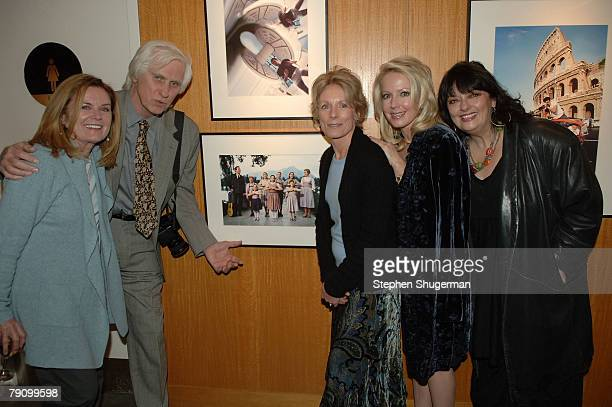 Actor Charmian Carrphotographer Douglas Kirkland actor Heather Menzies actor Kym Kareth and actor Angela Cartwright pose in front of a picture of the...