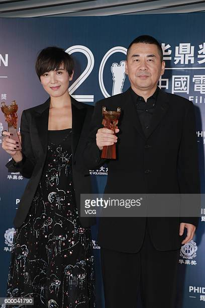 Actor Chen Jianbin and actress Song Jia pose during the 20th Huading Awards and China Film Satisfaction Survey Release Ceremony at Kowloon Bay...