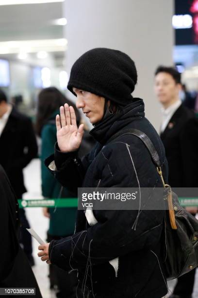 Actor Chen Kun is seen at an airport on November 21 2018 in Shanghai China Fashion brand Dolce Gabbana planned to hold 'The Great Show' on Wednesday...