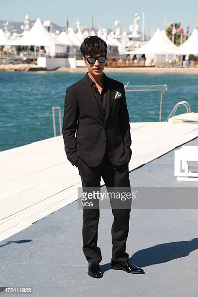 Actor Chen Kun poses near Cannes beach during their promoting 'The Ghouls' on the 68th annual Cannes Film Festival on May 15 2015 in Cannes France