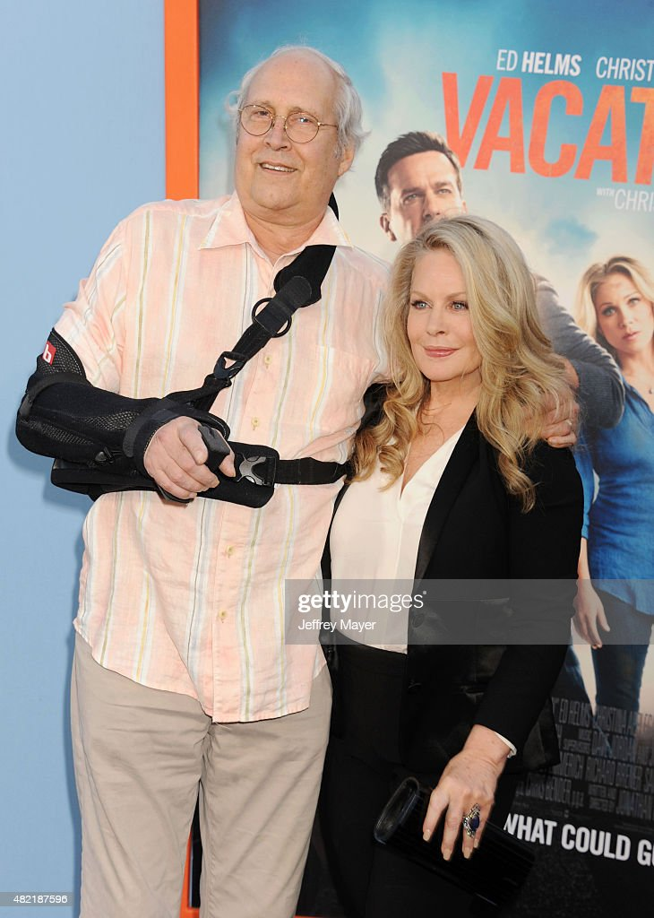 Actor Chevy Chase (L) and actress Beverly D'Angelo arrive at the Premiere Of Warner Bros. 'Vacation' at Regency Village Theatre on July 27, 2015 in Westwood, California.