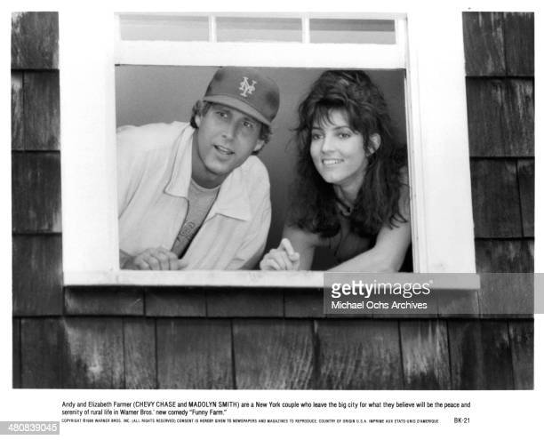 Actor Chevy Chase and actress Madolyn Smith Osborne in a scene from the Warner Bros movie 'Funny Farm ' circa 1988