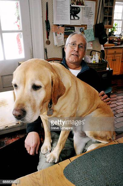Actor Chevy Chase at home with his pet dog New York 2014