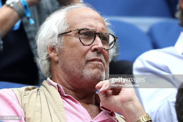 Actor Chevy Chase watches the men's singles semifinal match between Rafael Nadal of Spain and Juan Martin del Potro of Argentina on Day Twelve of the...