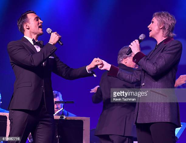 Actor Cheyenne Jackson and actress Jane Lynch perform onstage at amfAR's Inspiration Gala at Milk Studios on October 27 2016 in Hollywood California