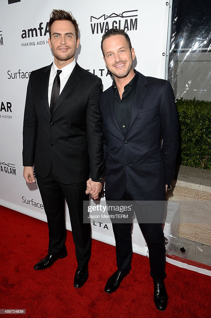 Actor Cheyenne Jackson (L) and guest attend the 2013 amfAR Inspiration Gala Los Angeles presented by MAC Viva Glam at Milk Studios on December 12, 2013 in Los Angeles, California.