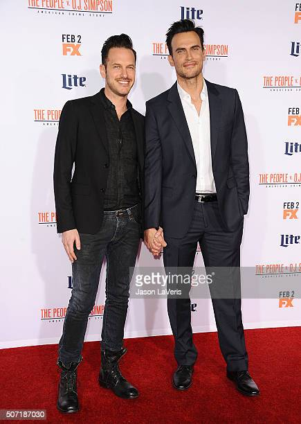 Actor Cheyenne Jackson and Jason Landau attend the premiere of 'American Crime Story The People V OJ Simpson' at Westwood Village Theatre on January...