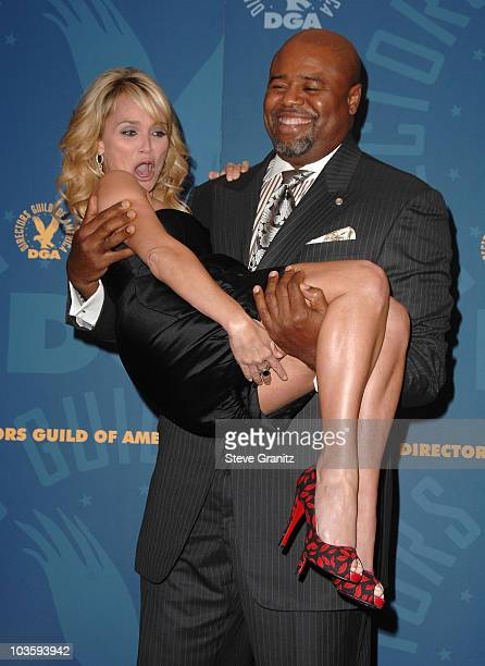 Actor Chi McBride picks up actress Kristin Chenoweth in the press room during the 60th annual DGA Awards held at the Hyatt Regency Century Plaza...