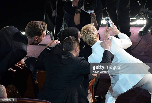 Actor Chiwetel Ejiofor actor/Producer Brad Pitt and Host Ellen DeGeneres take a selfie in the audience during the Oscars at the Dolby Theatre on...