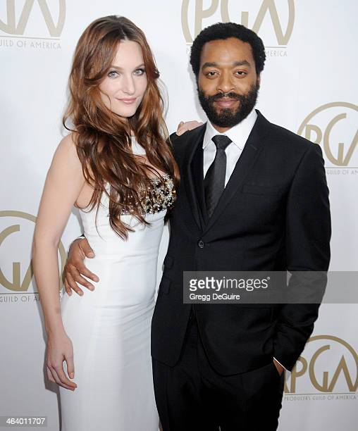Actor Chiwetel Ejiofor and Sari Mercer arrive at the 25th Annual Producers Guild Awards at The Beverly Hilton Hotel on January 19 2014 in Beverly...